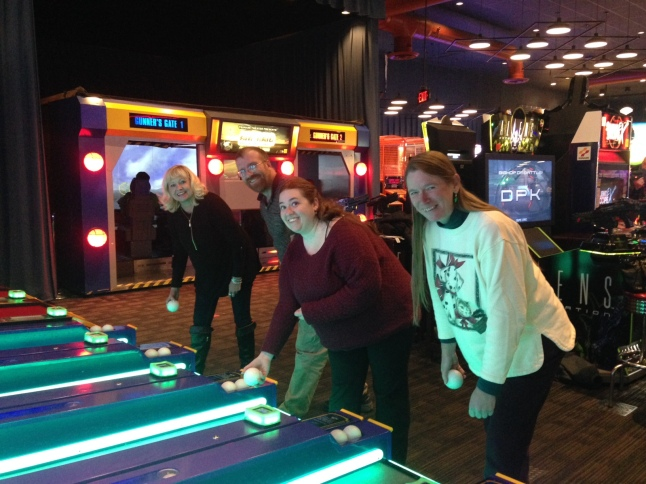 Bagels & Bytes attendees having fun playing ski-ball